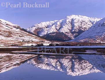 REFLECTIONS on LOCH DUICH with snow on the 