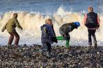 Children enjoy dodging waves at Penmon beach on 