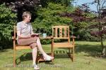 Senior woman looking sad sitting alone beside an 