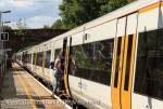 Female passenger boarding a London-bound 